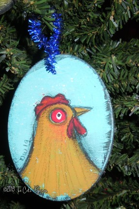 Chicken on teal Ornament